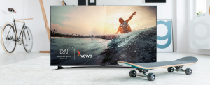 Campaign image for Adventure Sports Network and Vewd partnership. Image of surfer inset in a TV that is surrounded by a skateboard and a bicycle